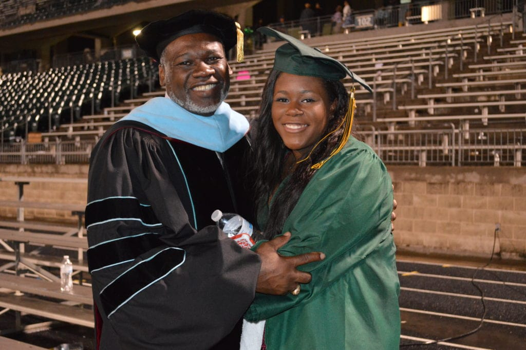 Dr. Harris takes a moment after presenting his daughter (Class of 2016) with her high school diploma.
