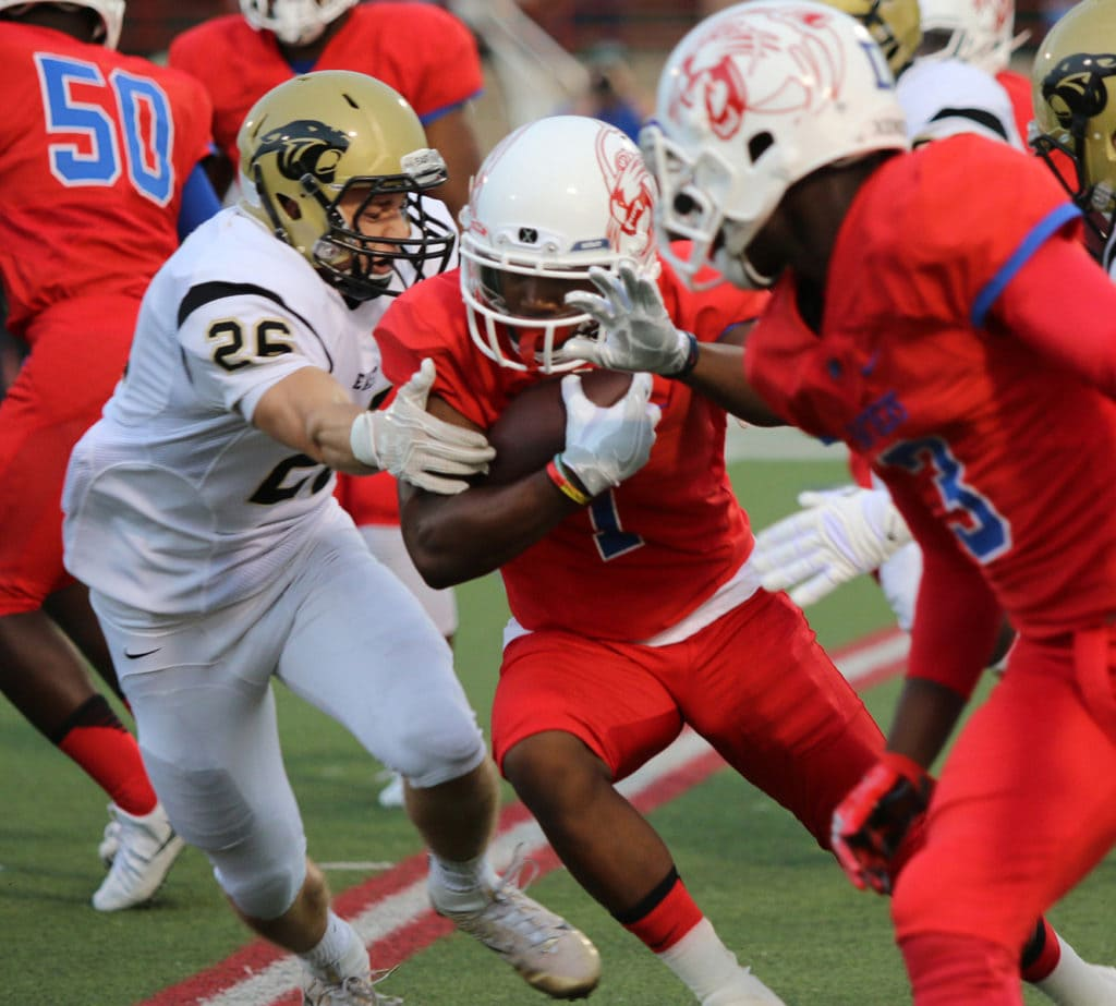 Running Back Tre Siggers pushes past a Plano East defender on the corner during Friday night's 36-32 win. (Jose Sanchez/Duncanville High School)