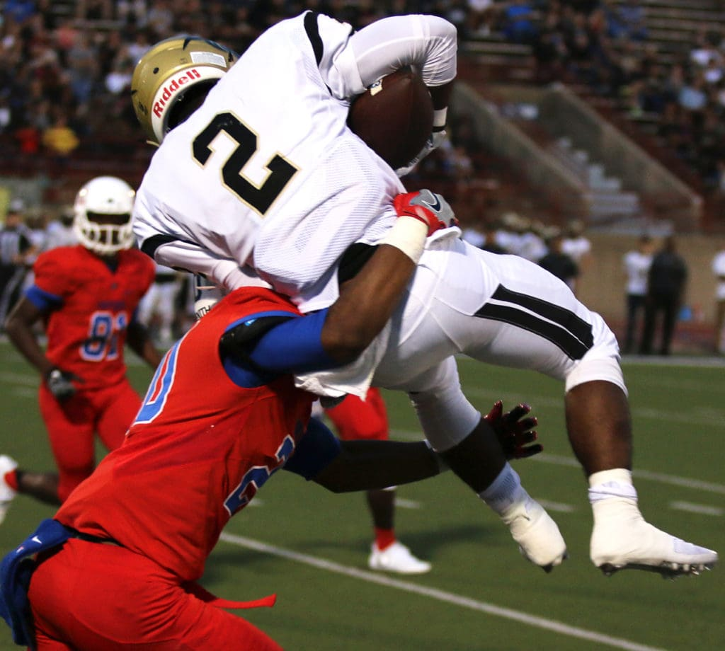 Sophomore Javon Fountain makes a big hit on Plano West's Wide Receiver. Duncanville won the game 36-32. (Ricardo Martin/Duncanville High School)