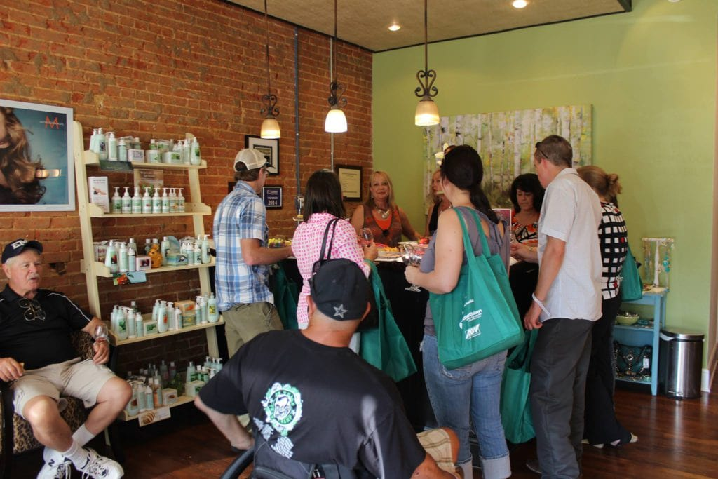 Midlothian businesses in the Historic Downtown District host wine stops during the 2015 Midlothian WIne and Arts Festival.