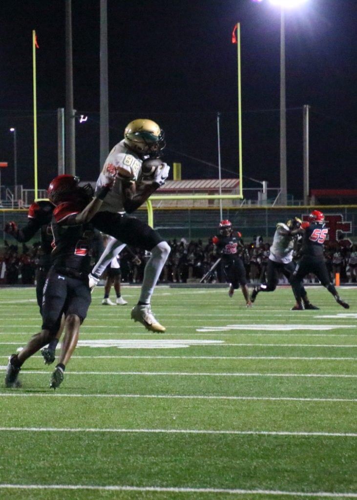Emmet Perry hauls down a pass on the 35 yard line as the Eagles defeat the Cedar Hill's Longhorns on Friday, September 23, 2016.