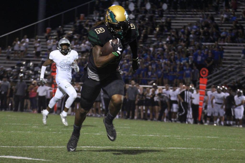 DeSoto wide receiver Laviska Shenault Jr. runs a 61 yard pass from Shawn Robinson to make the score 43 – 7. (Haley Arispe/DeSoto High School)