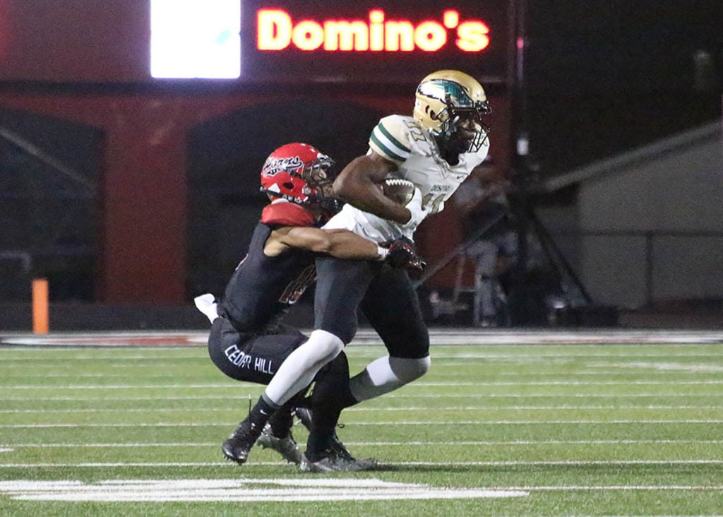 Sam Hunter hauls in pass to move the chains in the 3rd quarter of the game. After several game delays, Cedar Hill threatened to score several times. DeSoto defenders stopped them each time on Friday, September 23, 2016. Haley Arispe/DeSoto High School