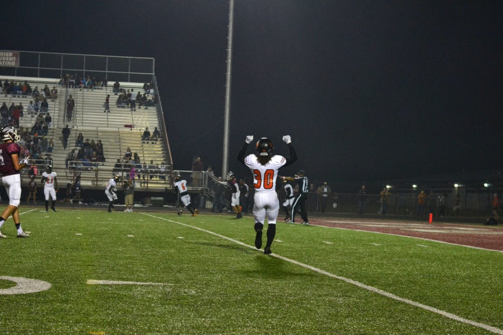 Lancaster High School defensive back Dimitri Miles (30, foreground) and Taiyoun Nichols (6, background), linebacker janarieon Reynolds (23, background) react to a Red Oak pass being broken-up near the goal line October 21, 2016. The Lancaster Tigers beat the Hawks 46-7 at Red Oak's Billy Goodloe Stadium. (Photo by Alexis Thames/Tiger Student Media}