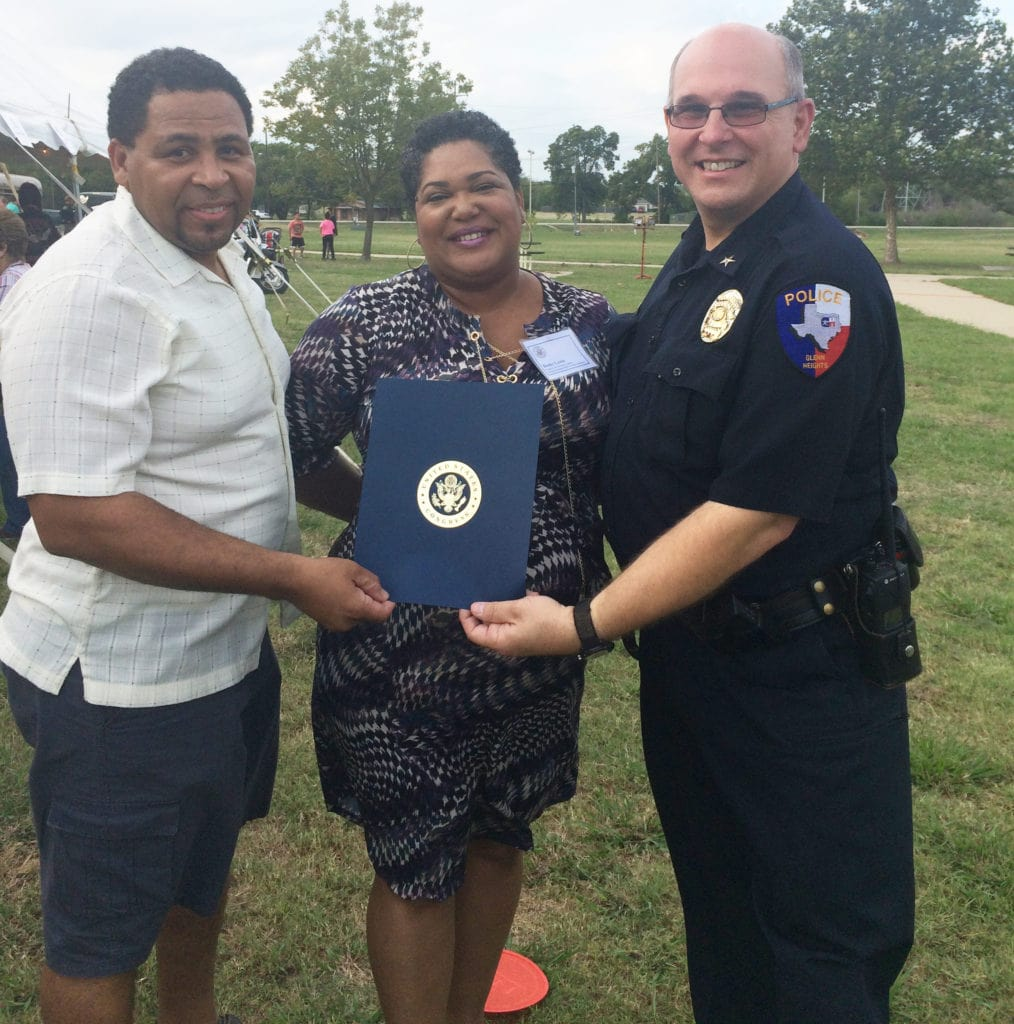 Mayor Leon Tate, Congressional Constituent Liaison Becky Lewis and Chief Phillip Prasifka poses for a photo during a recent National Night Out community event. Lewis presented a letter of appreciation on behalf of the Honorable Eddie Bernice Johnson to the Glenn Heights Department.