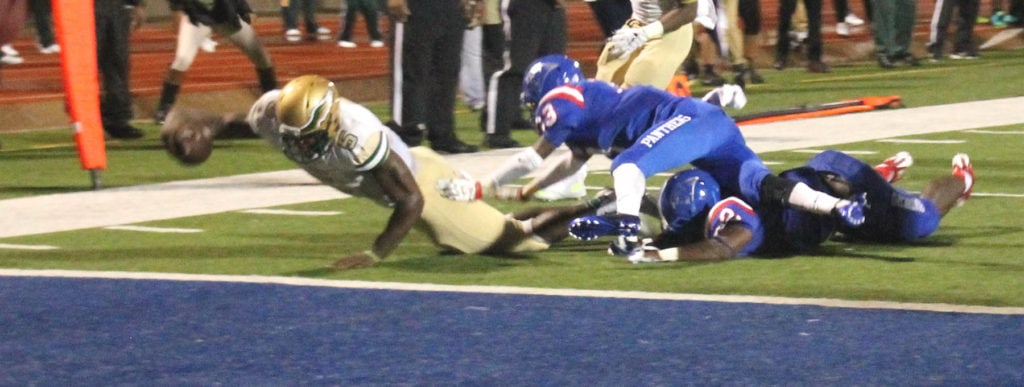 2015 DeSoto Quarterback Tristan Wallace scrambles for the first touchdown of the game in 2015.