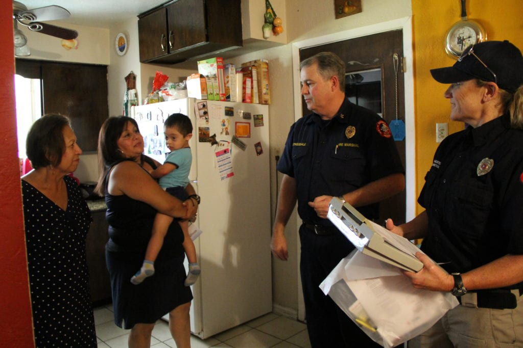 Duncanville Firefighters install smoke alarms in the home of local resident Juan Andrade.