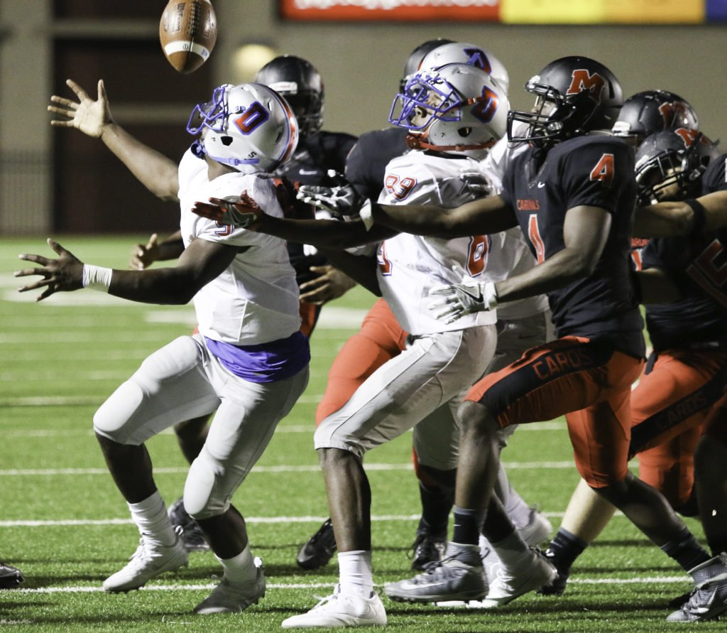 Duncanville fights for the ball as MacArthur fumbles early in the game near their own 20 yard line. (Reece Rodriguez/Duncanville High School)
