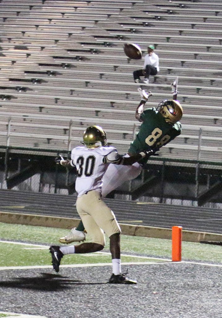 HIGH FLYING: Jarmarius Marshall leaps high to snag a pass from Shawn Robinson in the end zone to make the score 50—7. The PAT was food. (Photo by Marifer Vega/DeSoto High School)