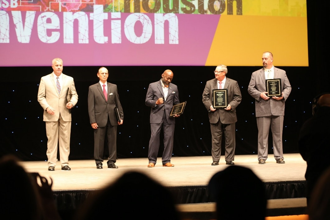 Board President Ty G. Jones accepts the award at the recent Texas Association of School Board Convention.