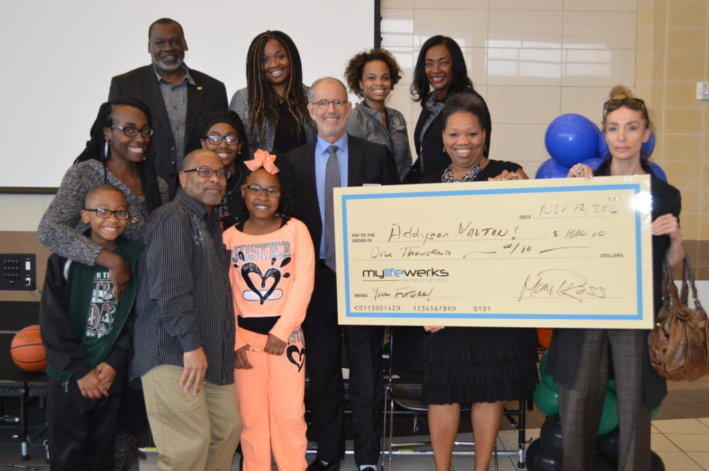 DeSoto ISD officials, event attendees present the $1,000 Scholarship to Addyson Walton at the recent Family Academy, Magnet Showcase.