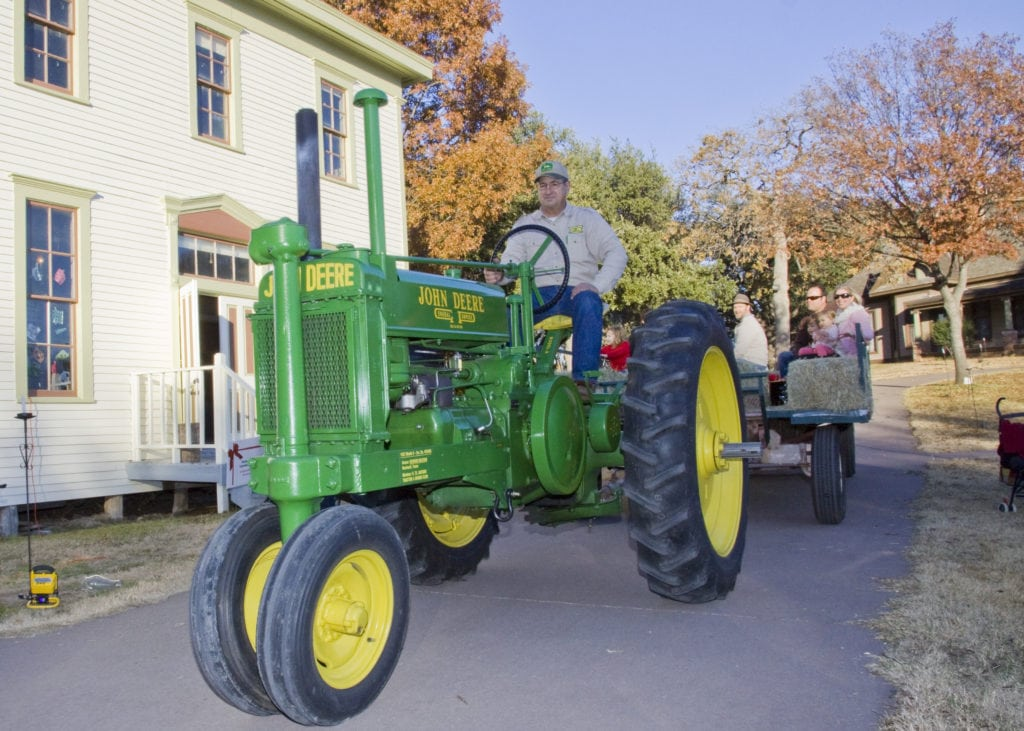 Take a hayride pulled by a vintage tractor at the Dallas Heritage Village.