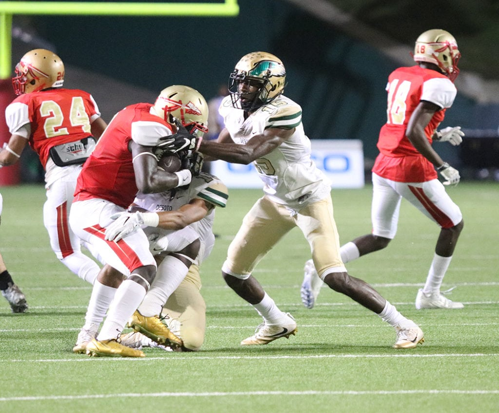 Orion Smith dashes the Warriors' hope as he brings down the South Grand Prairie Quarterback behind the line of scrimmage. The Eagles held the Warriors too only 131 yards on the ground. (Marifer Vega/DeSoto High School)