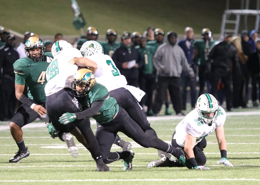 After Southlake scored early in the first half, the Eagle defense rose to the occasion forcing thee Dragons to kick from their own three yard line. It was all downhill from there as defensive players like Phillip Jones tackling the Southlake quarterback. (Photo by Marifer Vega/DeSoto High School)