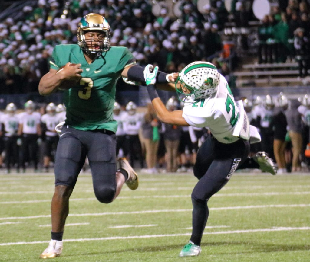 Quarterback Shawn Washington caps a scoring drive by adding two points at the end of the first half to give the Eagles a 29-23 lead. Early in the second half the Eagles scored three more times en route to a convincing win. (Photo by Santos Salazar/DeSoto High School)