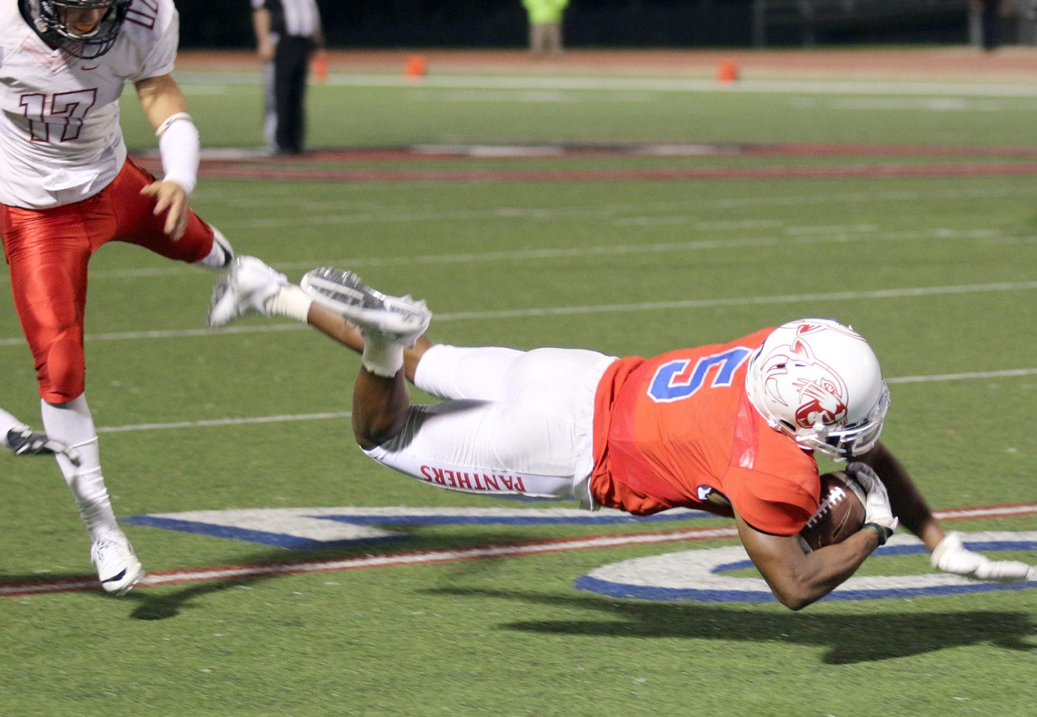 Duncanville Wide Receiver Tre Siggers dives for a catch at the Harker 20 yard line. Siggers gained 64 yards in the Panthers 24-7 win Friday, November 11 at home. (Jose Sanchez/Duncanville High School)