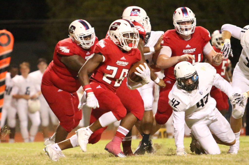 """Junior, Donald """"Tray"""" Gamble runs against the Bishop Lynch Friar defense on Friday, September 23, 2016. The Falcons won this match 28-21."""