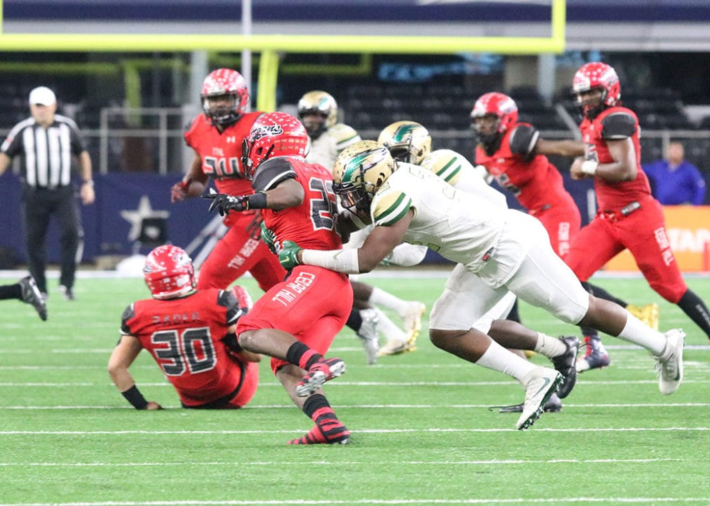 Tyler Jackson brings down Cedar Hill Running Back Jihad Thomas for a loss. (Marifer Vega/DeSoto High School)