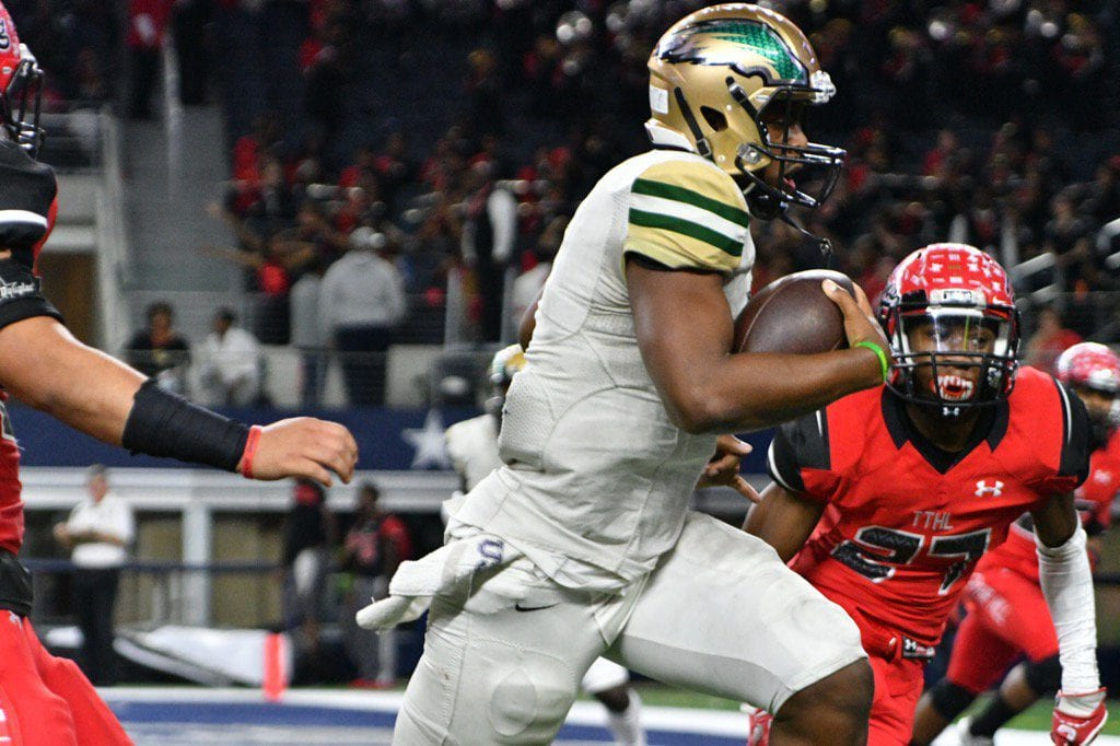 Dual threat quarterback Shawn Robinson proves his mettle with back to back options and rushes for DeSoto's fifth touchdown. Another botched snap results in a failed extra point, 33-13. (Vance Valentine/Special Contributor)
