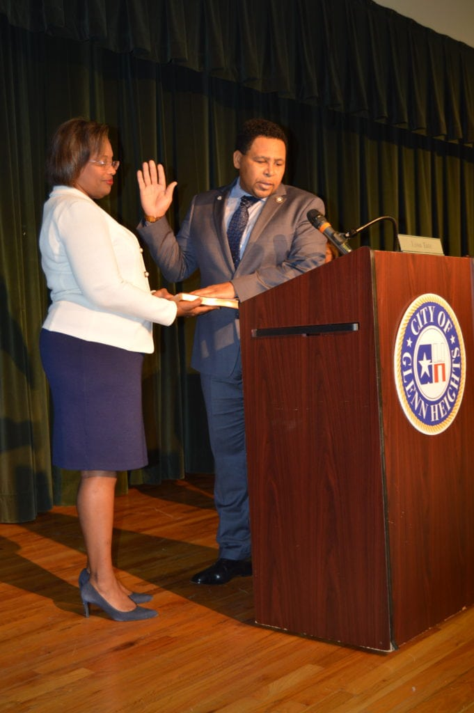 Glenn Heights City Manager Aretha Ferrell-Benavides administers oath of office to Mayor Leon Tate.