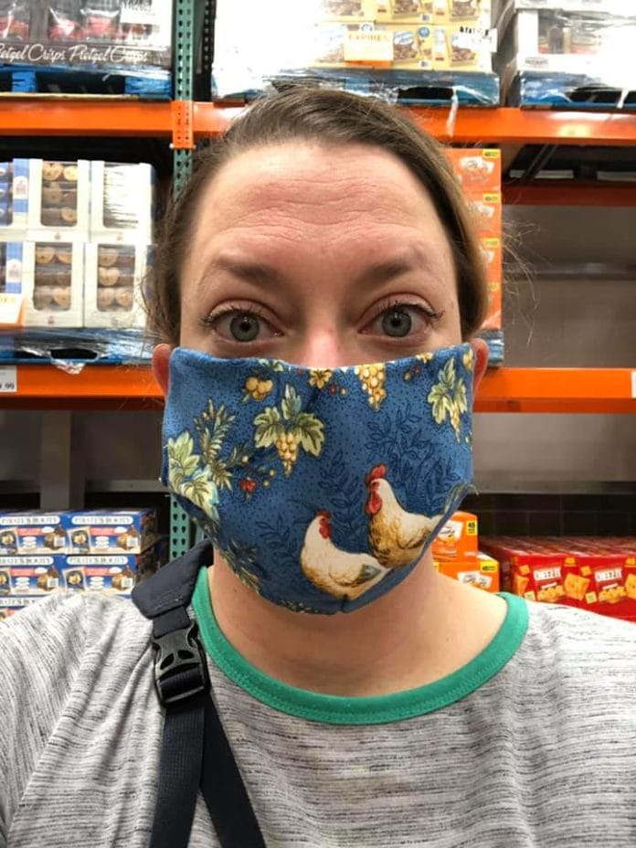 lady wearing face mask with roosters
