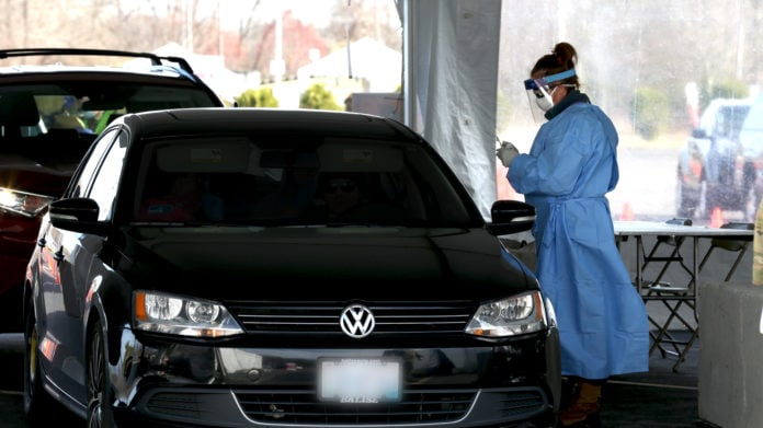 healthcare worker by car
