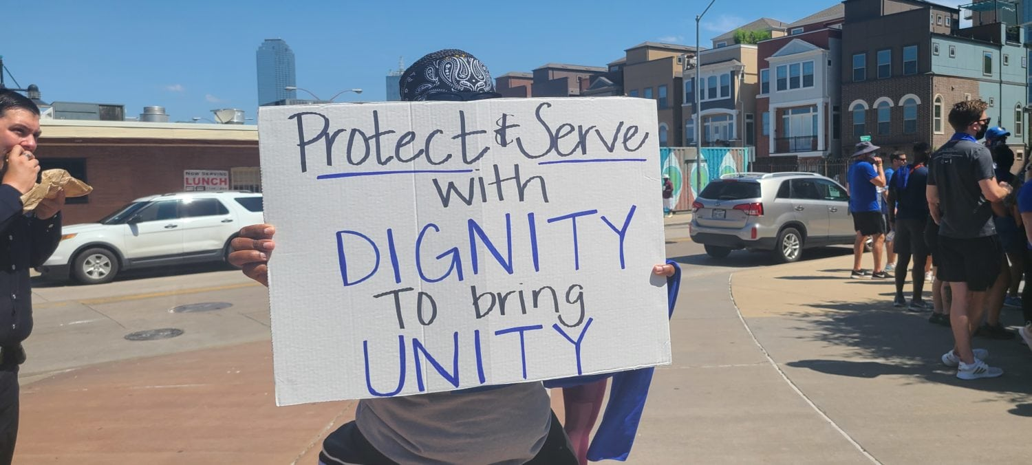 protect and serve protest sign