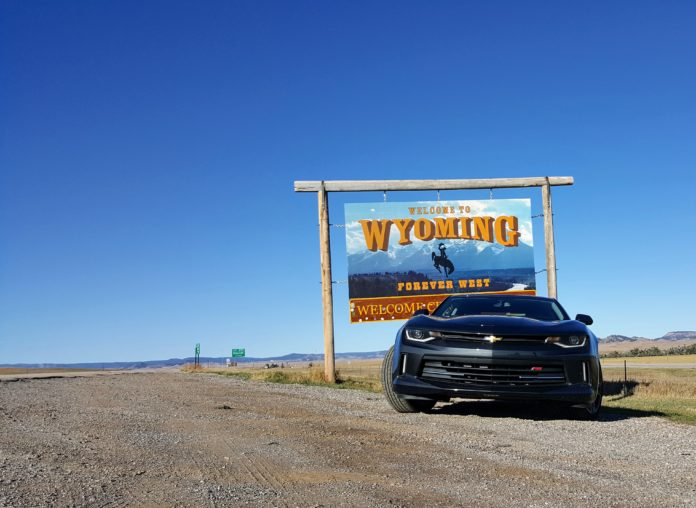 Camaro in front of Wyoming State Sign
