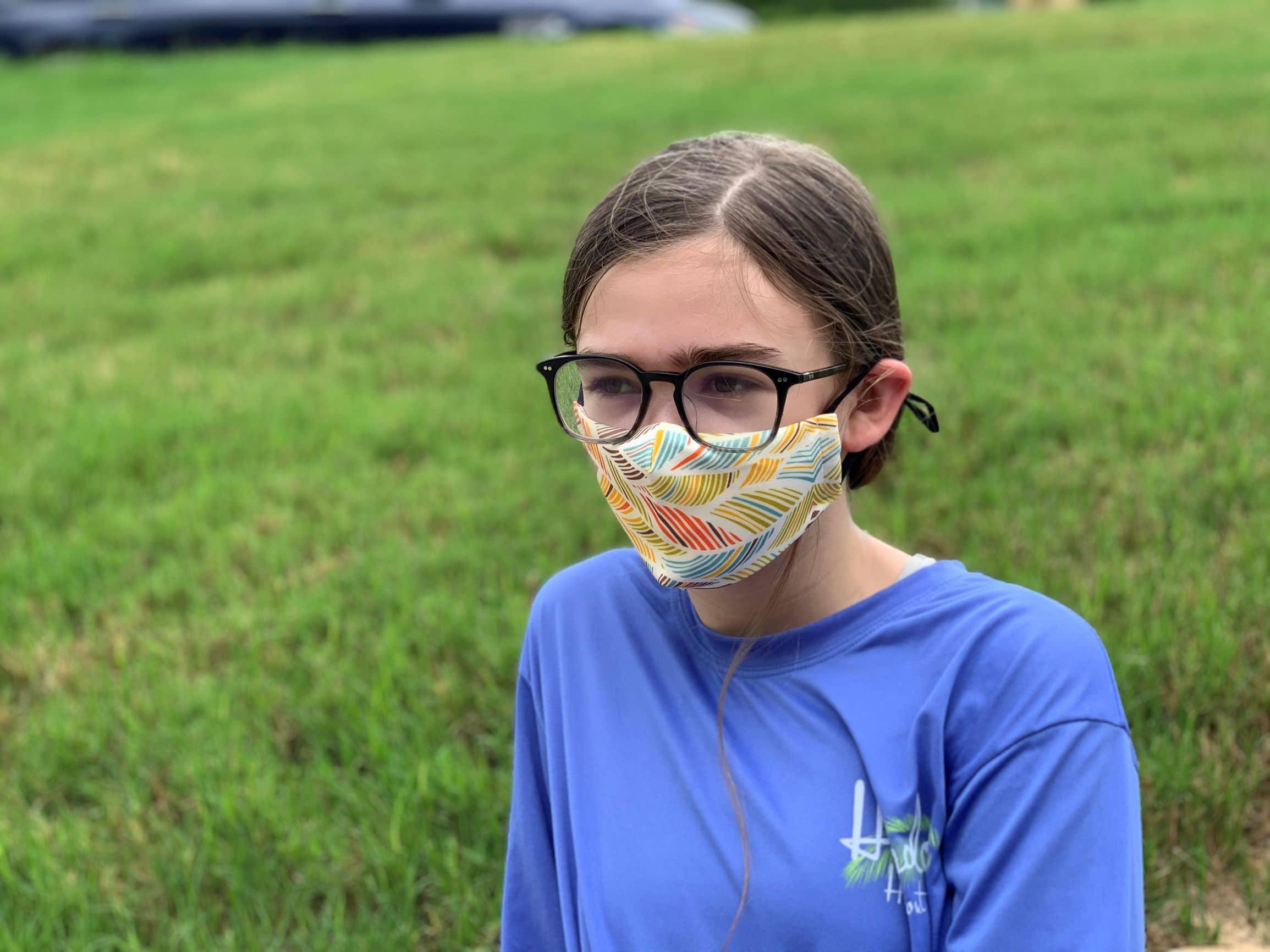 Girl wearing face mask from fase wear