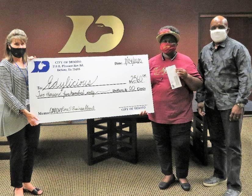 DeSoto residents accept grant check