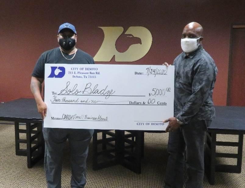 Solo Bladze receives grant check from DeSoto