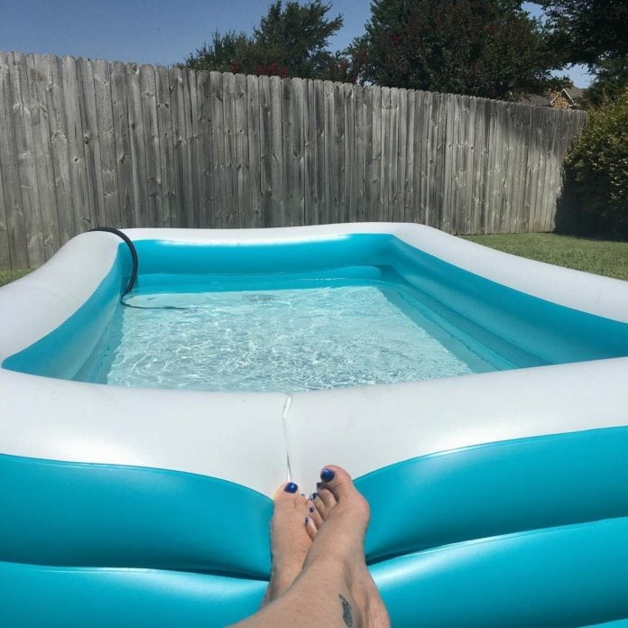 feet resting on inflatable pool