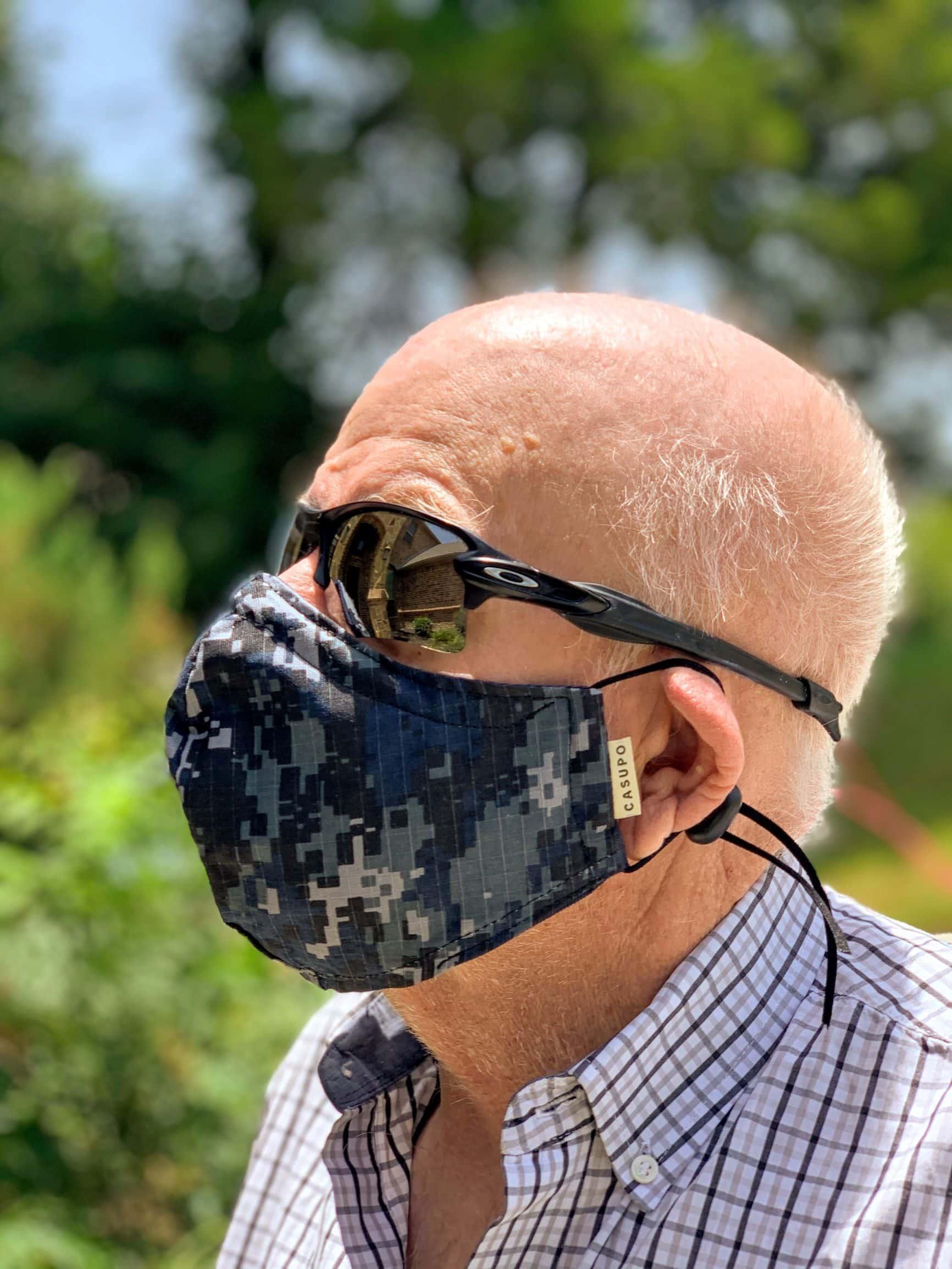 Man wearing navy blue camo face mask