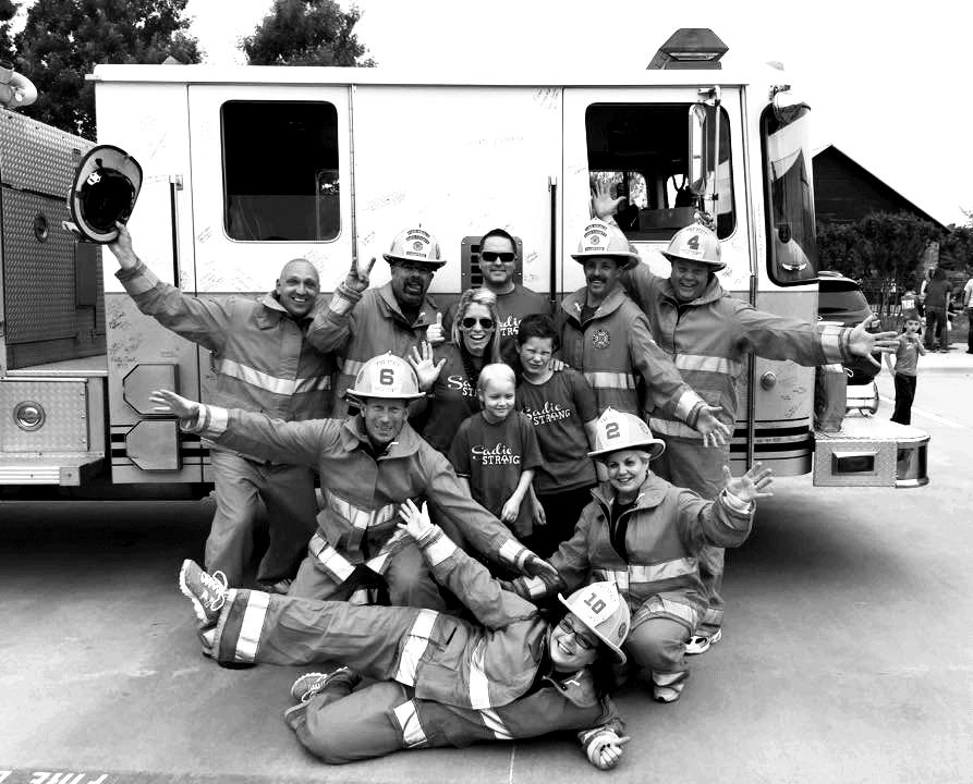 Sadie Keller with firemen