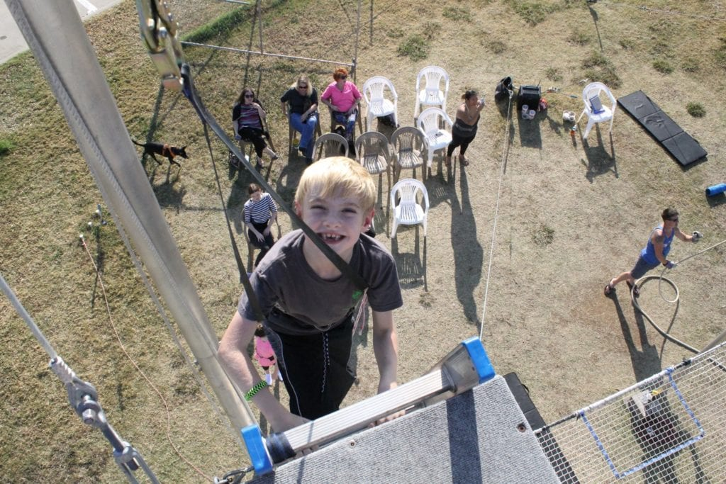 boy climbing ladder for trapeze