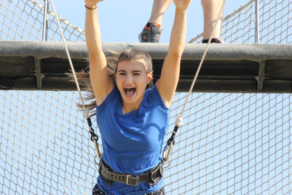 young girl in trapeze harness
