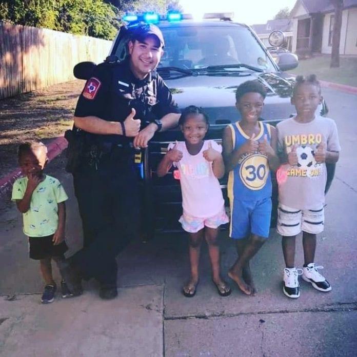 joseph urias poses with children
