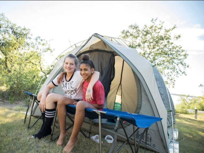 Two girls camping in a tent