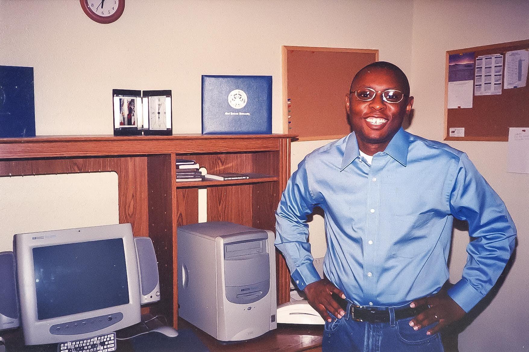 Kevin Graham in front of desk