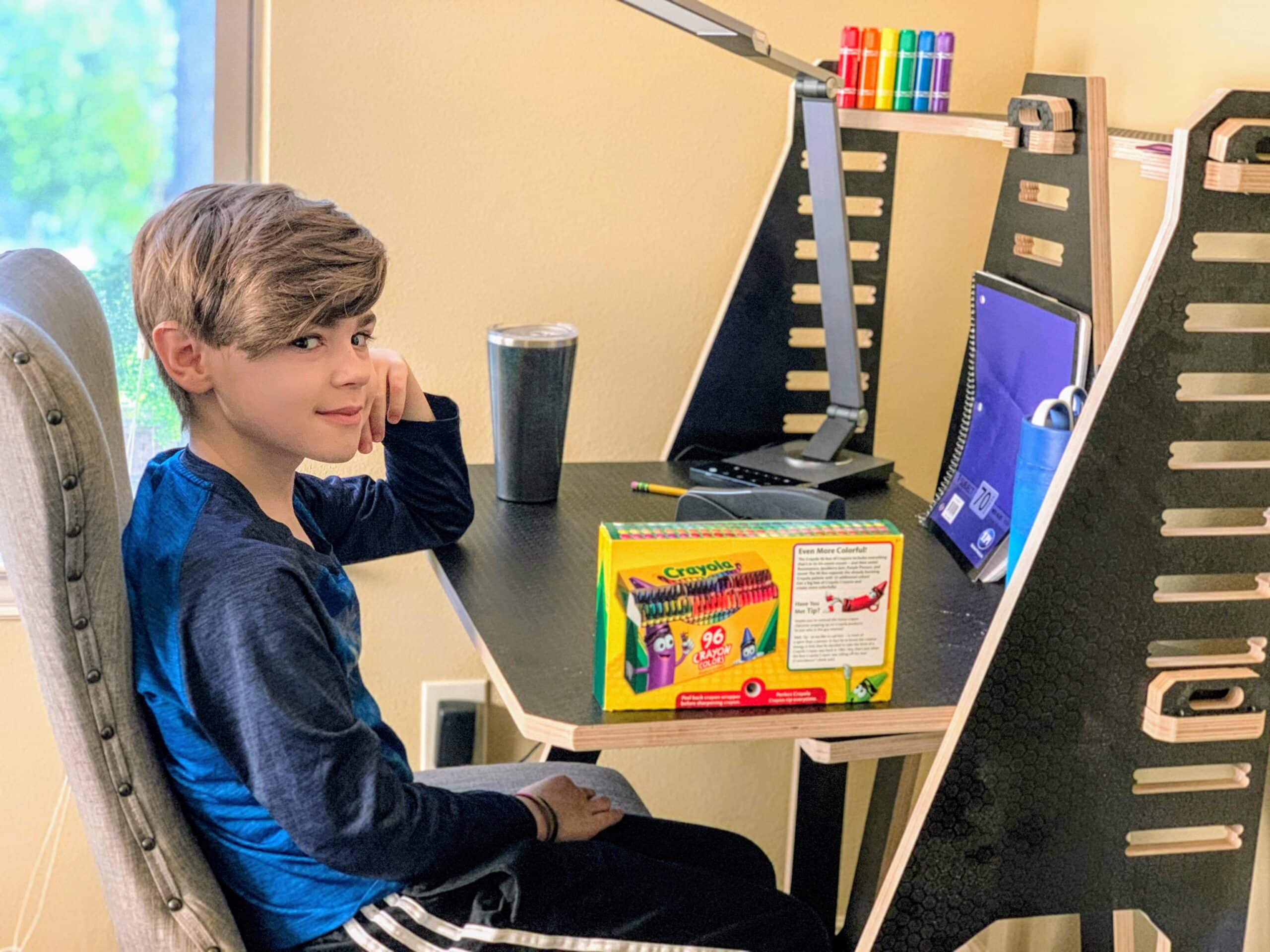 boy sitting at work from home desk