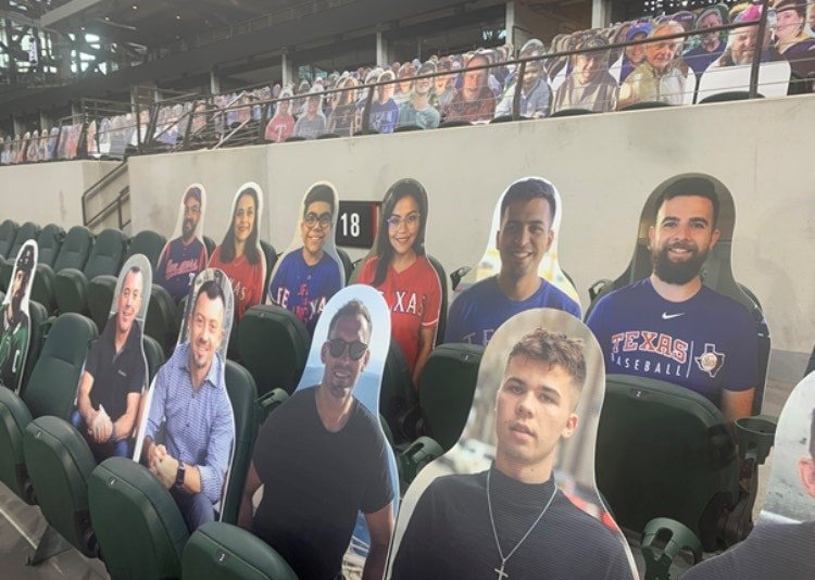 cutouts of kids at Rangers game