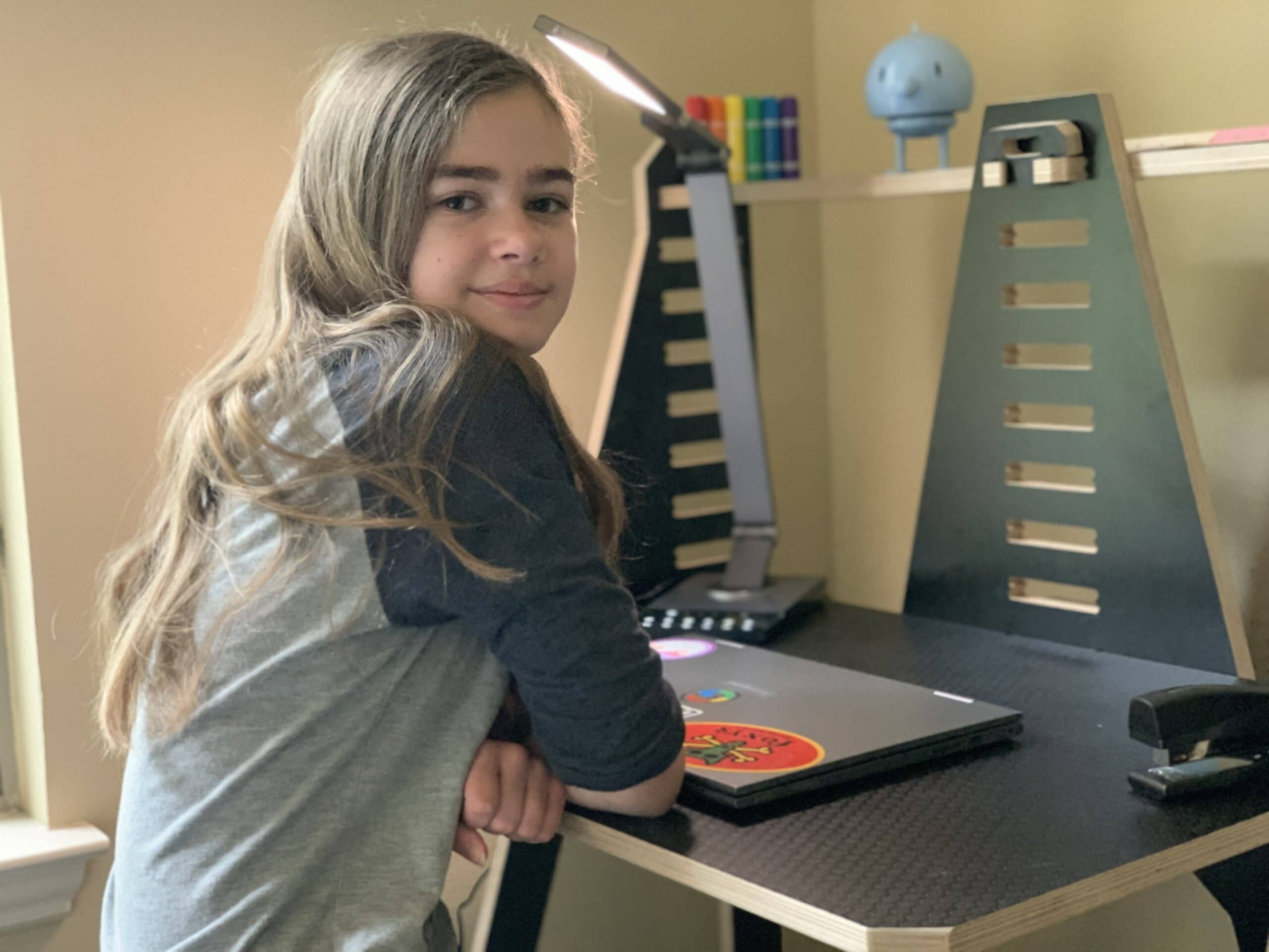 Girl sitting at work from home desk