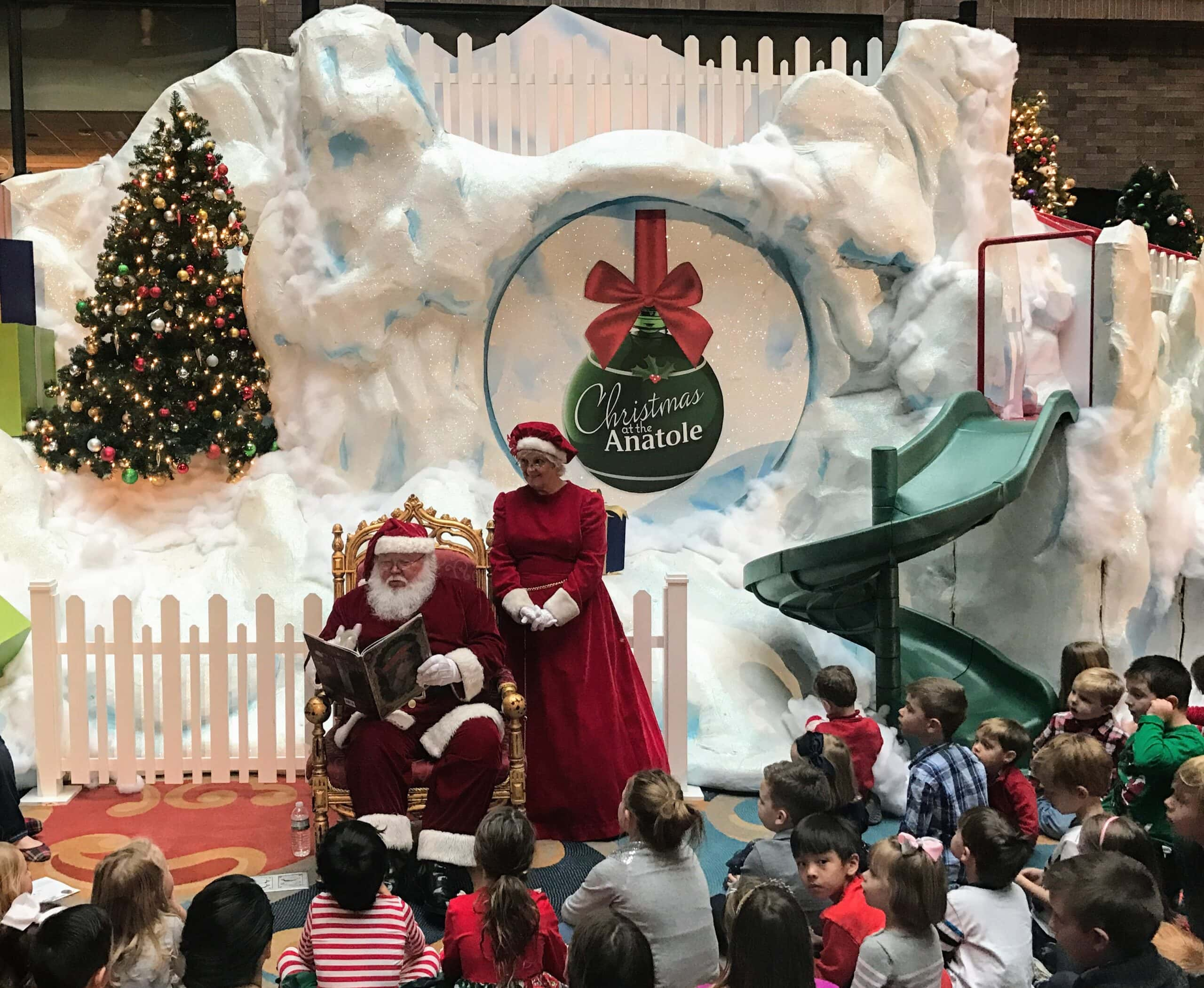Santa reads a story to children