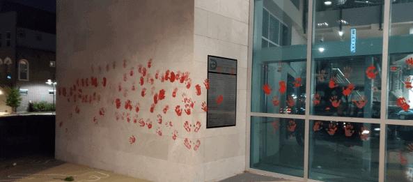 handprints on Dallas Police Building