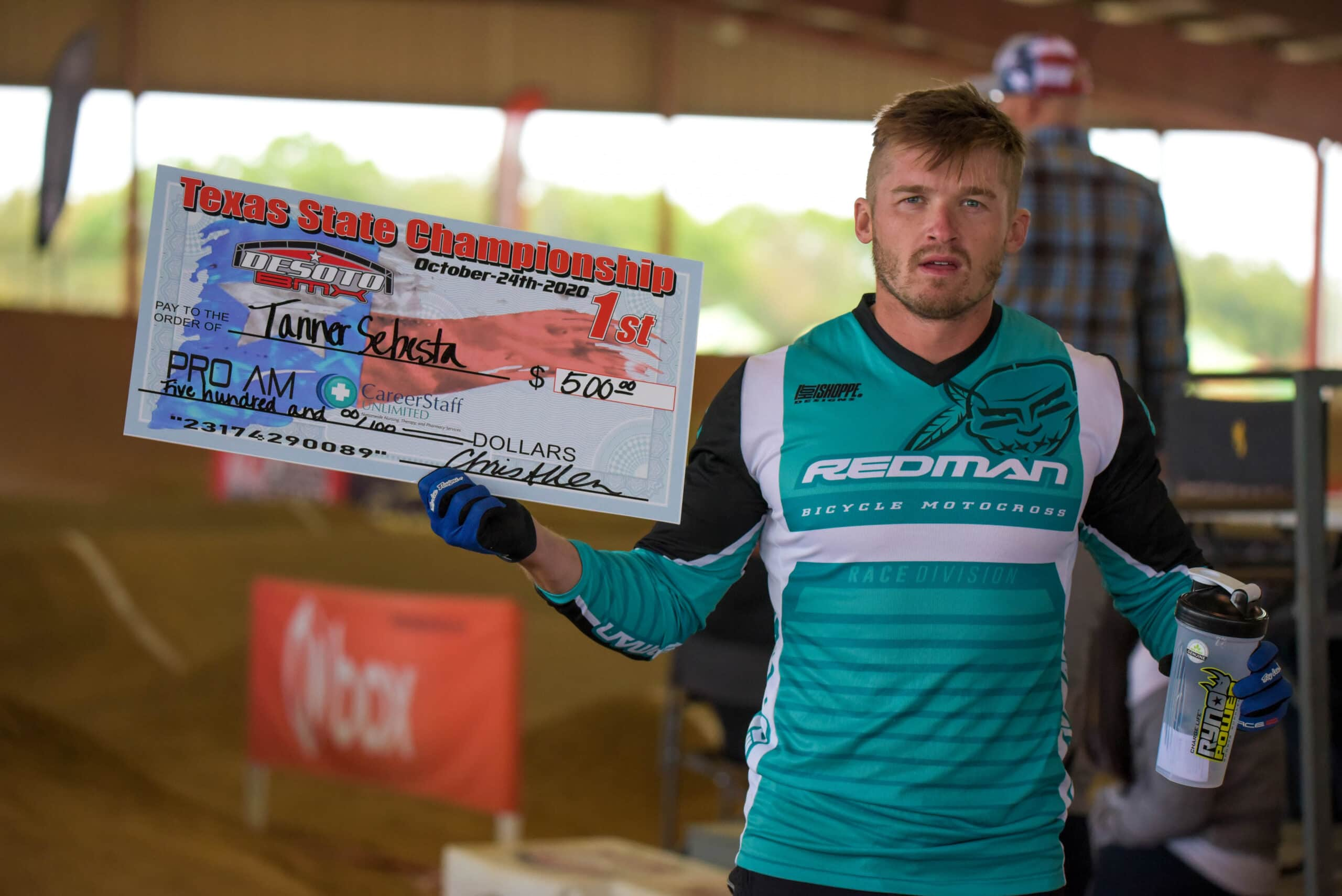 Man holds check