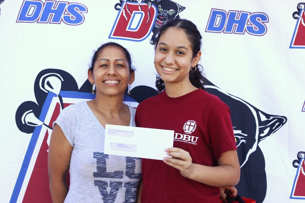 Duncanville ISD receives technology donation, distributes checks