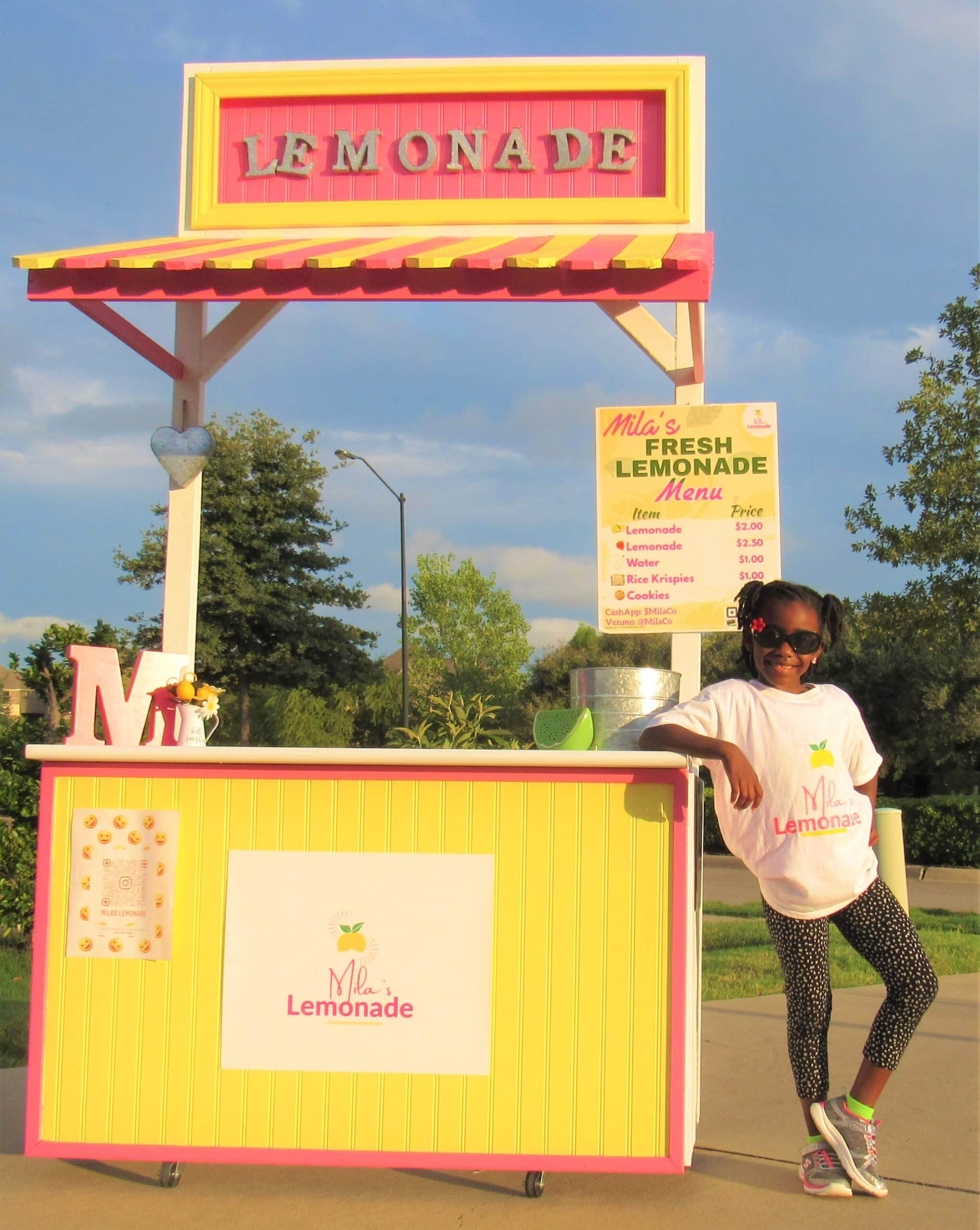 Mila with her lemonade stand