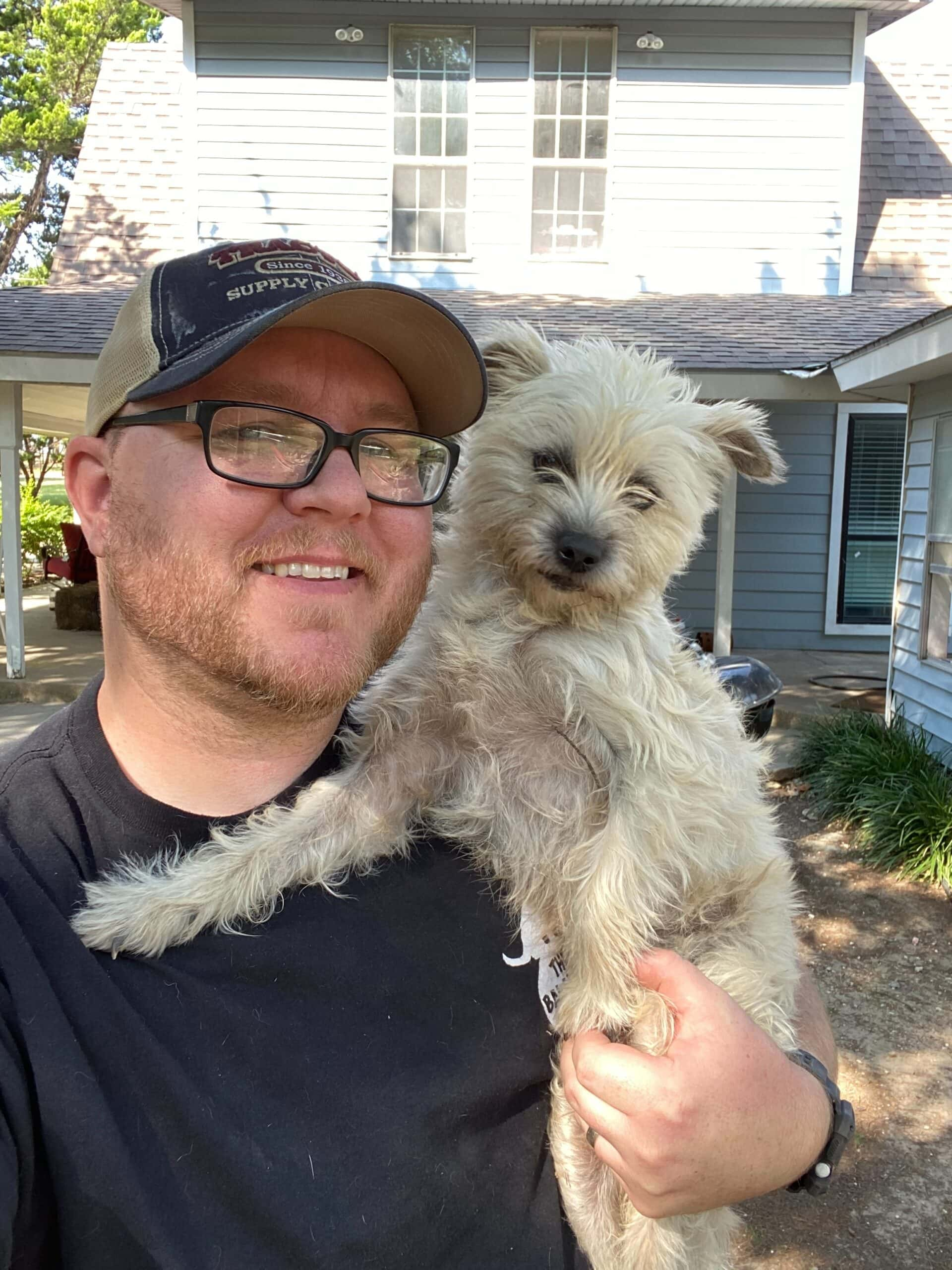 Matt Morris holding dog