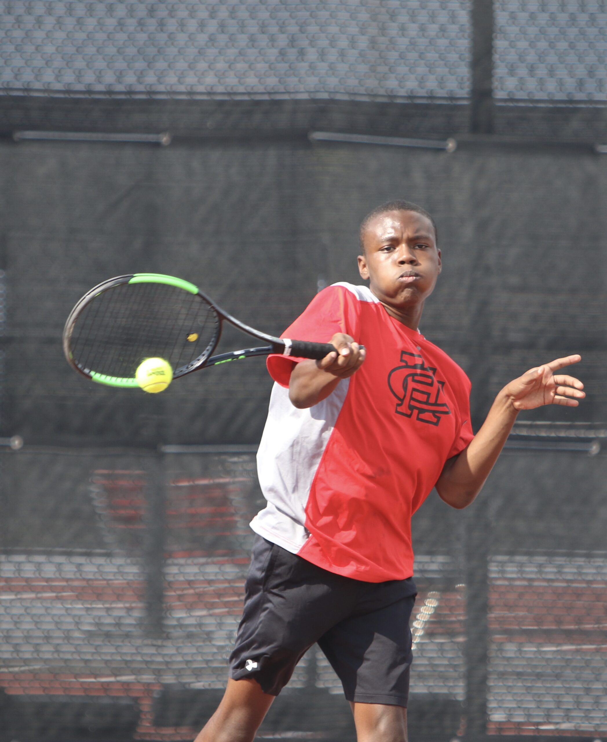 Tyrell Oliver playing tennis