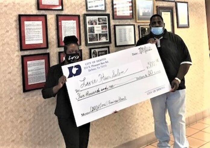 man and woman hold check